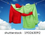 Stock photo laundry hanging on a clothesline concept for love and romance with two shirts embracing each other 193263092