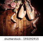 Ballet pointe shoes on wooden...