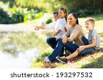 Young Family Of Four Sitting B...