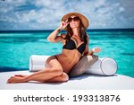 sexy woman sitting on cozy... | Shutterstock . vector #193313876