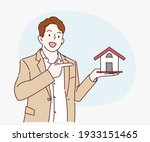 young business man holding home ... | Shutterstock .eps vector #1933151465