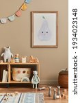 Small photo of Stylish scandinavian newborn baby room with brown wooden mock up poster frame, toys, plush animal and child accessories. Cozy decoration and hanging cotton flags on the beige wall. Template.