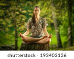 young female meditate in park. | Shutterstock . vector #193403126