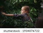 A Little Girl Among Many Green...