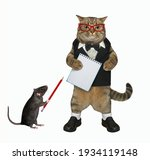 A Beige Cat In A Black Suit And ...