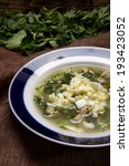 Small photo of Russian spring soup shchi with young nettle leaves, wild garlic and eggs