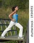 woman exercising outdoor | Shutterstock . vector #1934593