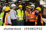 Small photo of Team of factory workers or technicians celebrate the success together. Collective appreciation and team effort in a factory. Leadership in teamwork
