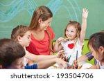 girl raising her hand in...   Shutterstock . vector #193504706