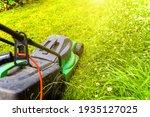 Man Cutting Green Grass With...
