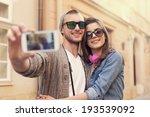 Fashionable Couple Taking Selfie By - Fine Art prints