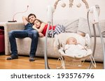 young parents watchin tv while... | Shutterstock . vector #193576796