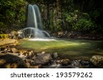 Waterfall And A Rock Pool In...