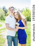 Happy Couple With Bouquet Of...