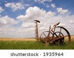A Rusty Farm Tool In A Field