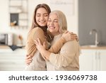 Young Woman And Mother Spending ...