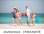 Happy Family On The Beach At...