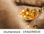 Fish Oil Capsules On A Wooden...