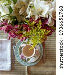 Small photo of Florid and feminine table set for coffee