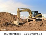 Excavator On Earthworks At...