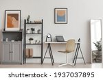 Small photo of Background of minimal home office workplace in modern apartment decorated by plants and abstract art, copy space