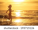 woman running at the beach in... | Shutterstock . vector #193715126