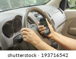 senior woman driving car and calling with mobile phone - stock photo