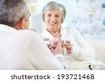 mature woman taking small pink...   Shutterstock . vector #193721468