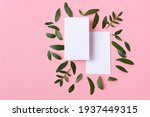 two white business cards on a...   Shutterstock . vector #1937449315