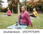 Multiracial women doing yoga...
