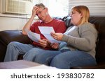 worried couple sitting on sofa... | Shutterstock . vector #193830782