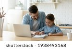 Caring young dad helping small...