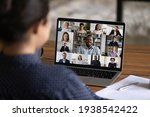 Small photo of Over shoulder view of female worker have webcam digital virtual conference with diverse multiethnic colleagues. Woman speak talk on video call with multiracial businesspeople. Online meeting concept.