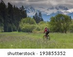 cycling through fields with the ... | Shutterstock . vector #193855352