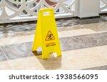 Yellow warning sign caution wet ...