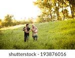 happy young couple is walking... | Shutterstock . vector #193876016