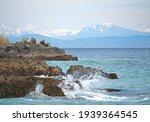 Waves Crash On The Rocks At...