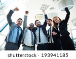 Group Of Ecstatic Business...