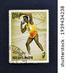 Small photo of Burundi - circa 1965 : Cancelled postage stamp printed by Burundi, that shows Shot-put and promotes Summer Olympic Games 1964 - Tokyo, circa 1965.
