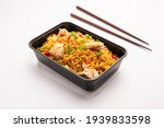 chicken fried rice packed in a...