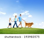 Stock photo family walking together with their pet dog outdoors 193983575