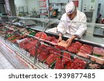 Small photo of Normandy, France, May 2013. Meat department of a supermarket. Meat stall like beef, roast beef, roast pork, roast lamb