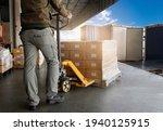 Warehouse Worker Unloading...