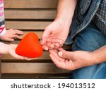 red heart at the human hands  | Shutterstock . vector #194013512