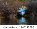 Rowboat Among The Reeds On The...