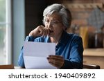 Small photo of Ugly news. Distressed old age hispanic female check documents at home office read debt bankruptcy information in financial report. Upset stressed older latin woman get bad surprise in official letter
