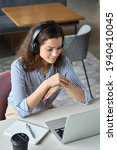 Small photo of Hispanic girl college student wearing headphones watching distance online learning web class, remote university webinar or having talk on laptop video call virtual meeting seminar at home or campus.