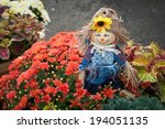 A Tiny Scarecrow Is Placed In A ...
