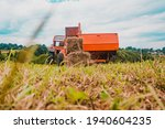 Old Tractor In The Field ...