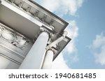 Corner With White Pillars Of...